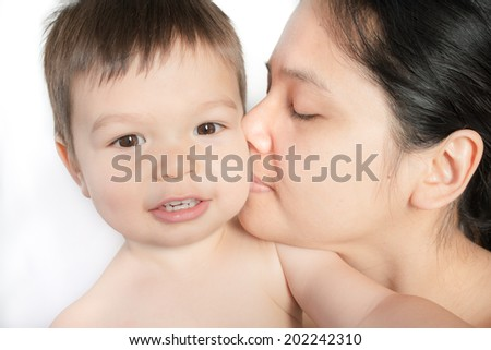 18 month old mixed race Asian boy plays happily with his Asian mom. Looking at camera