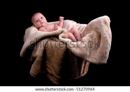 3 month old naked baby in a laundry basket - stock photo