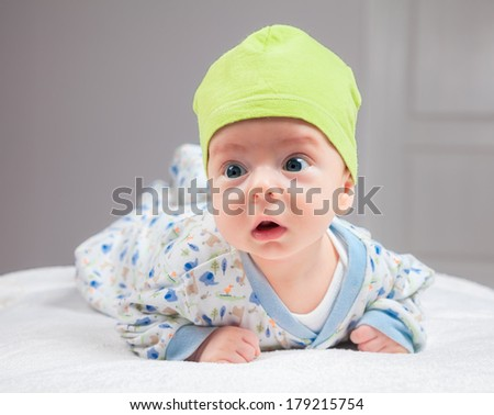 2 months baby boy doing tummy time at home. - stock photo