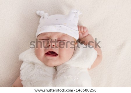 3 months baby girl in cap portrait - stock photo