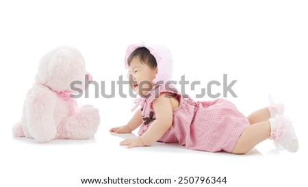6 months old asian baby playing with toy - stock photo