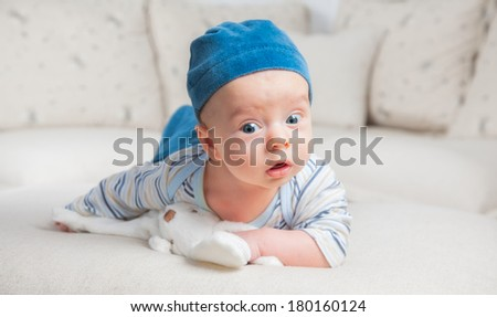 3 months old baby boy portrait at home. - stock photo