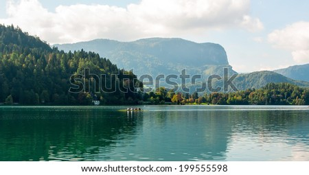morning rowers training on the  lake - stock photo