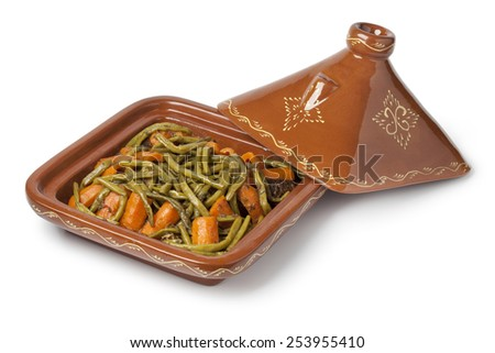Moroccan square tagine with meat, green beans and carrots on white background - stock photo
