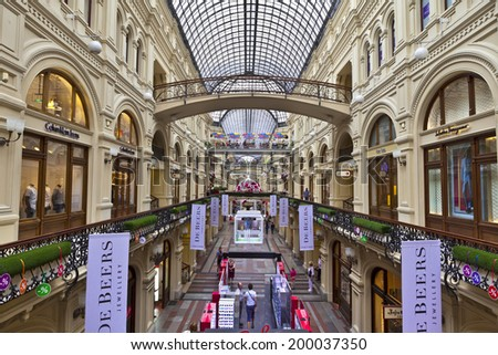 MOSCOW - JUNE 9, 2014: Inside famous GUM the large store in the Kitai-gorod part of Moscow facing Red Square. It is currently a shopping mall. - stock photo