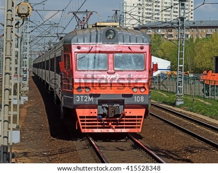 MOSCOW, RUSSIA - MAY 04, 2016: ET-2M commuter train arriving to the Ostankino station of Oktyabrskaya railway