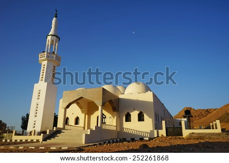 Mosque in mountains .Sunrise and moon .Dahab. South Sinai. Egypt .