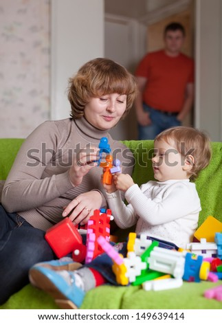 mother and child plays with toys in home - stock photo