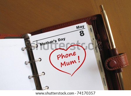 "Mother's day diary date in a personal organizer with a heart and ""phone Mum"" - stock photo"