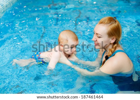 mother with her son in the pool. prevention of diseases of the musculoskeletal system. Swimming lessons for children. health - stock photo