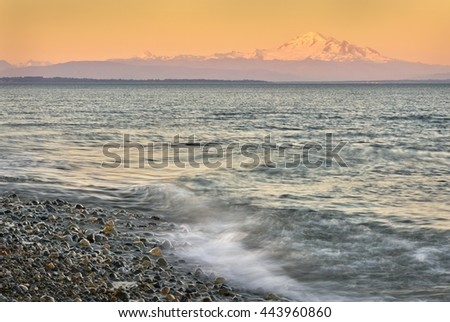 Mount Baker Sunset. Boundary Bay, Point Roberts, Washington State at sunset. Mount Baker rises in the background.                               - stock photo