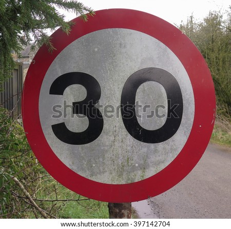30 mph Road Sign in the Rural Village of Parwich within The Peak District National Park, Derbyshire, England, UK - stock photo