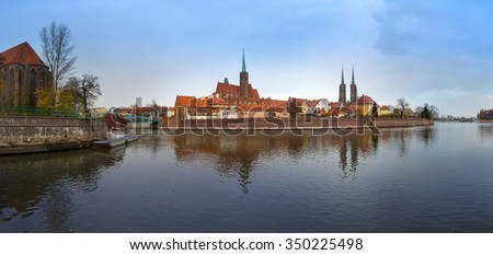 55 mpx Panoramic view of famous old island Tumski with cathedral of St. John reflection in the Odra river at dusk. Wroclaw, Poland, EU. - stock photo