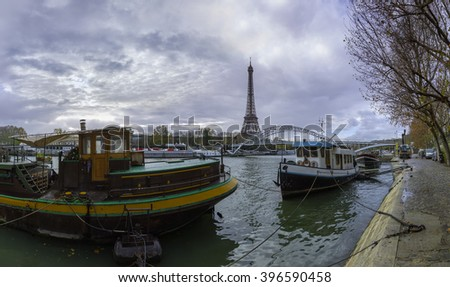 14 mpx panoramic view of the Eiffel Tower and Passerelle Debilly bridge from the river Seine embankment and residential house barge, Paris, France. Autumn. - stock photo