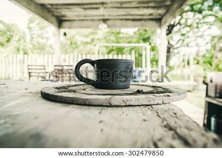 Mug raw ceramic (Do not burn)on background , Shallow Depth of Field - stock photo