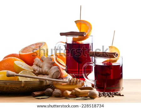 mulled wine with spices and fruits on white background - stock photo