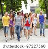 Multi-ethnic group of people outdoors. - stock photo