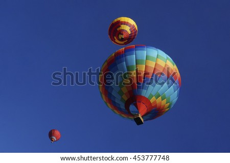 Multicolored balloons in the sky - stock photo