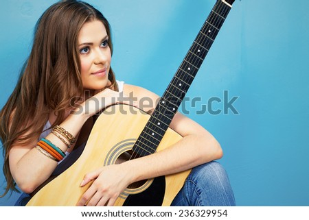 musician girl with guitar . 60s style hippie woman portrait . - stock photo