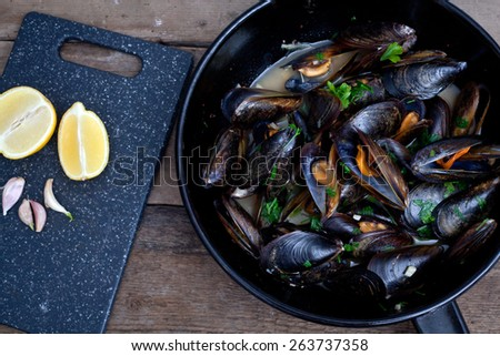 Mussels cooked with white wine sauce. - stock photo