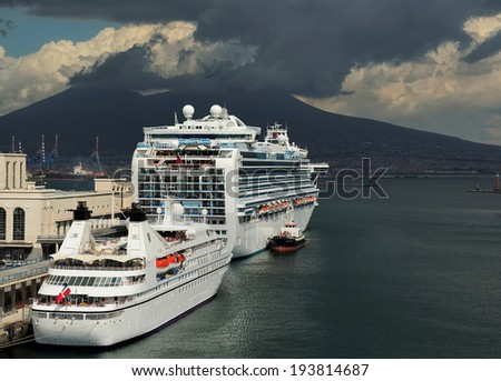 Naples, Italy - May 13,2013: cruise ships at port of Naples and volcano Vesuvius