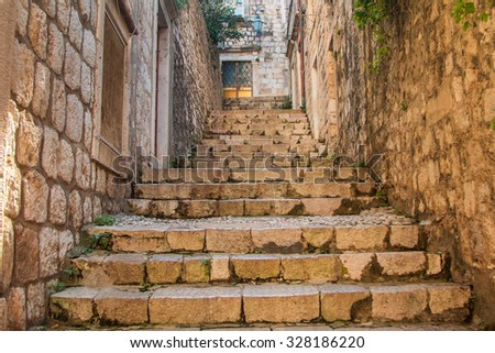 Narrow street and stairs in the Old Town in Dubrovnik, Croatia, Mediterranean ambient - stock photo