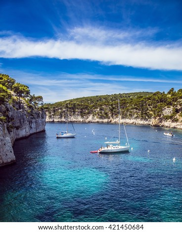 National Park Calanques on the Mediterranean coast. The picturesque narrow fjords between the rocky shore. White sailing boats waiting for tourists - stock photo