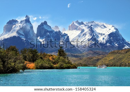 National Park Torres del Paine, Chile.  Azure Lake Pehoe at the foot of the magnificent snow-covered cliffs of Los Kuernos - stock photo