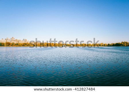 Natural forest lake under blue sky in Summer , Central Park. - stock photo