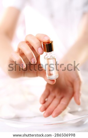 Natural oil for nail care.The bottle with the preparation for the care of cuticles and nails - stock photo