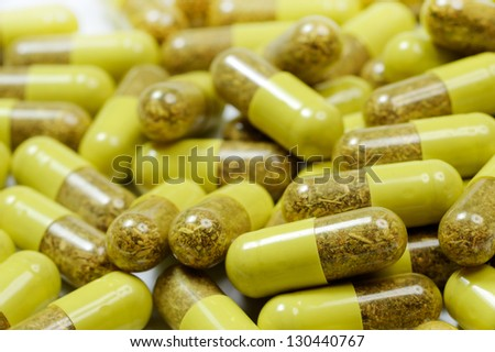 natural pills on white background