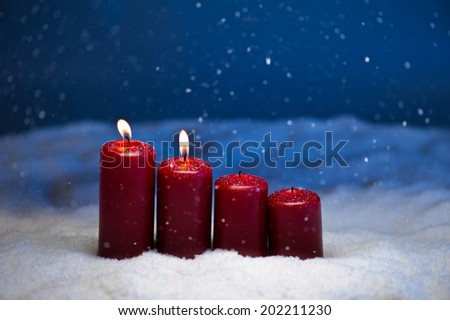 2nd Advent candles in snow and snowfall - stock photo