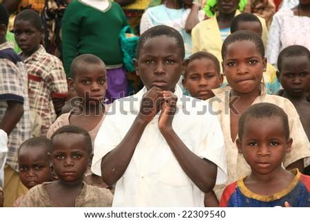 2nd November 2008. Refugees cross from DR Congo into Uganda at the border village of Busanza. - stock photo