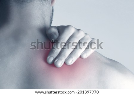 Neck pain  Acute pain in a neck at the young man. - stock photo