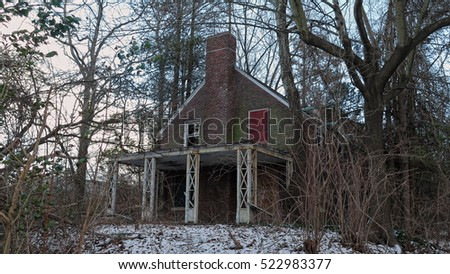Neglected and abandoned house on a cold, clear winter day.