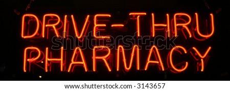 """neon sign series"" ""drive-thru pharmacy"" - stock photo"