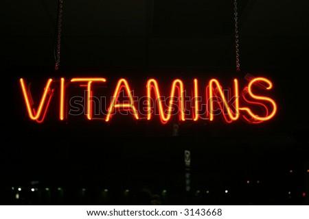 """neon sign series"" vitamins - stock photo"
