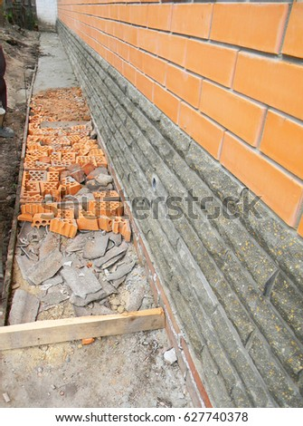 New Construction Waterproofing Basement Walls From Outside With Detail Of A  Pavement To Walk. Building
