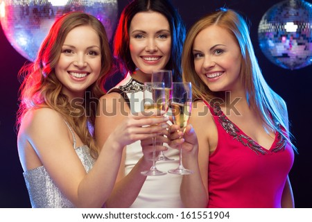 """""""new year"""", celebration, friends, bachelorette party, birthday concept - three beautiful woman in evening dresses with champagne glasses - stock photo"""