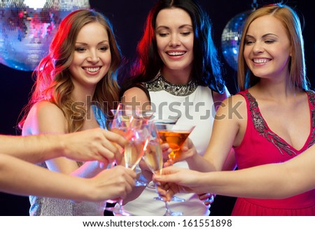 """new year"", celebration, friends, bachelorette party, birthday concept - three women in evening dresses with cocktails in club or bar"