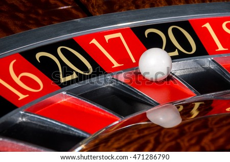 2017 New Year classic casino roulette wheel with red sector seventeen 17 and white ball and sectors 20, 17, 16, 18 wishes to you good luck in year 2017