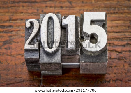 2015  - New Year concept  - text in vintage metal type over gungre wood - stock photo