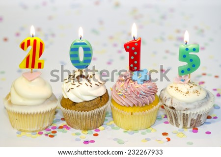 2015 new year cupcakes on abstract colorful background