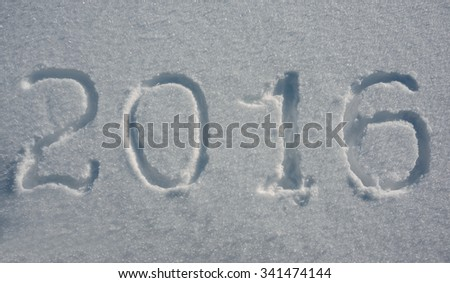 2016 New Year is written on the snow background.