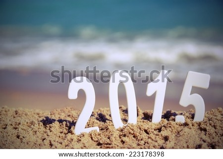2015 New Year numbers on the sea beach. Background and Texture for text or image - stock photo