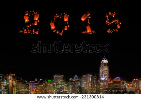 2015 New Year over city at night. - stock photo