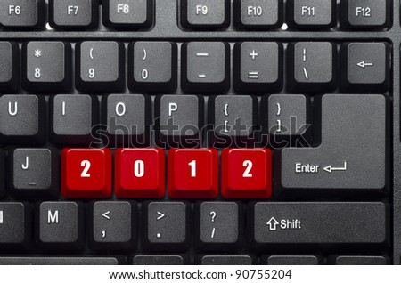 2012 new year red button word on black keyboard