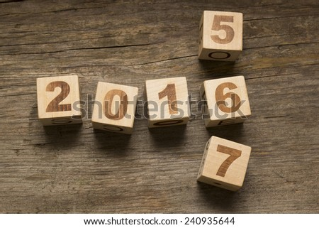 2016 New Year wooden cubes on a wooden background - stock photo