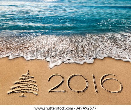 new year 2016 written in sand  sea and blue sky