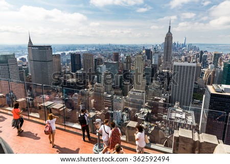 ?NEW YORK - AUGUST 23: View to Downtown Manhattan with the famous Empire State Building on August 23, 2015. This view is from the rooftop of an another skyscraper. - stock photo